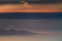 Sinking Moon Above The Clouds over Favignana